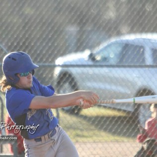Halstead Dragon Bryant Odendahl (#23) takes a swing at a pitch in the top of the second inning. The Hoisington Cardinals defeated the Halstead Dragons by a score of 10 to 6 at Legion Field in Hoisington, Kansas on April 27, 2018. (Photo: Joey Bahr, www.joeybahr.com)