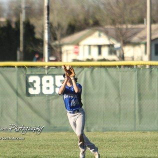Halstead Dragon Noah Mendez (#24) catches a fly ball in center field during the bottom of the second inning. The Hoisington Cardinals defeated the Halstead Dragons by a score of 10 to 6 at Legion Field in Hoisington, Kansas on April 27, 2018. (Photo: Joey Bahr, www.joeybahr.com)