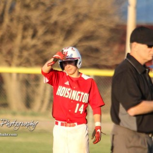 Hoisington Cardinal Braxton Donovan (#14) looks to his coach for what to do in the bottom of the third inning. The Hoisington Cardinals defeated the Halstead Dragons by a score of 10 to 6 at Legion Field in Hoisington, Kansas on April 27, 2018. (Photo: Joey Bahr, www.joeybahr.com)