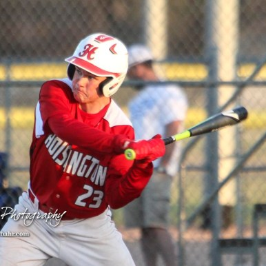 Hoisington Cardinal Chris Fuentes (#23) swings at a pitch in the bottom of the fourth inning. The Hoisington Cardinals defeated the Halstead Dragons by a score of 10 to 6 at Legion Field in Hoisington, Kansas on April 27, 2018. (Photo: Joey Bahr, www.joeybahr.com)