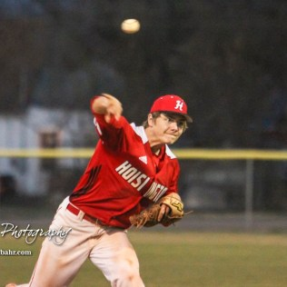 Hoisington Cardinal Myles Menges (#4) throws a pitch in the top of the sixth inning. The Hoisington Cardinals defeated the Halstead Dragons by a score of 10 to 6 at Legion Field in Hoisington, Kansas on April 27, 2018. (Photo: Joey Bahr, www.joeybahr.com)