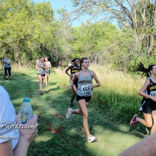 Spectators wait for the runner they are cheering on to pass by on the course. The Great Bend Cross Country Invitational was held at Lake Barton near Great Bend, Kansas on August 30, 2018. (Photo: Joey Bahr, www.joeybahr.com)
