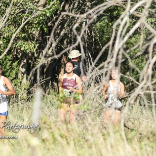 Hutchinson's Jacqueline Lewton (#374) leads two other runners on the course. The Great Bend Cross Country Invitational was held at Lake Barton near Great Bend, Kansas on August 30, 2018. (Photo: Joey Bahr, www.joeybahr.com)