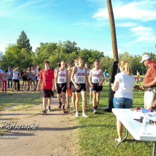 The Great Bend boys varsity team approach to collect their team first place medals. The Great Bend Cross Country Invitational was held at Lake Barton near Great Bend, Kansas on August 30, 2018. (Photo: Joey Bahr, www.joeybahr.com)
