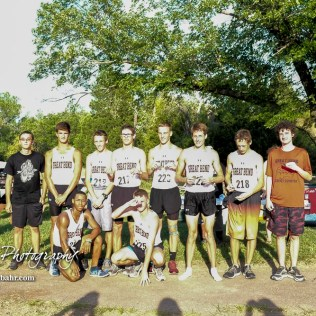 The Great Bend boys varsity team pose with their first place team medals. The Great Bend Cross Country Invitational was held at Lake Barton near Great Bend, Kansas on August 30, 2018. (Photo: Joey Bahr, www.joeybahr.com)