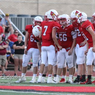 Hoisington Cardinal #7 Mason Haxton tells the next play to his teammates in the first quarter. The Pratt Greenbacks defeated the Hoisington Cardinals by a score of 34 to 0 at Elton Brown Field in Hoisington, Kansas on August 31, 2018. (Photo: Joey Bahr, www.joeybahr.com)