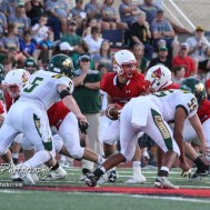 Hoisington Cardinal #7 Mason Haxton looks for a player to hand the ball off to in the first quarter. The Pratt Greenbacks defeated the Hoisington Cardinals by a score of 34 to 0 at Elton Brown Field in Hoisington, Kansas on August 31, 2018. (Photo: Joey Bahr, www.joeybahr.com)