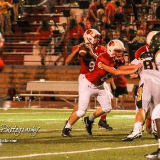 Hoisington Cardinal #9 Derek Boxberger looks for an open receiver in the third quarter. The Pratt Greenbacks defeated the Hoisington Cardinals by a score of 34 to 0 at Elton Brown Field in Hoisington, Kansas on August 31, 2018. (Photo: Joey Bahr, www.joeybahr.com)