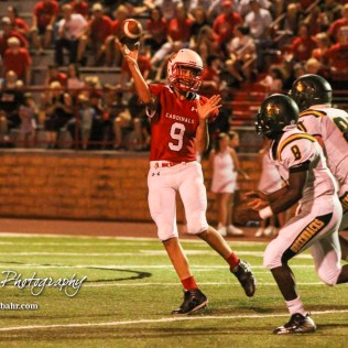 Hoisington Cardinal #9 Derek Boxberger throws a pass over the defense of Pratt Greenbacks #8 Kurtis Veninga and #80 Jarrett Bates in the third quarter. The Pratt Greenbacks defeated the Hoisington Cardinals by a score of 34 to 0 at Elton Brown Field in Hoisington, Kansas on August 31, 2018. (Photo: Joey Bahr, www.joeybahr.com)