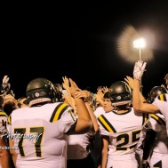 Members of the Pratt Greenbacks hold up four fingers to signify the start of the fourth quarter. The Pratt Greenbacks defeated the Hoisington Cardinals by a score of 34 to 0 at Elton Brown Field in Hoisington, Kansas on August 31, 2018. (Photo: Joey Bahr, www.joeybahr.com)