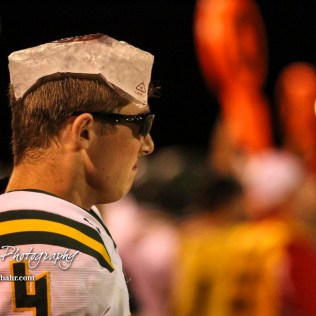 Pratt Greenback #4 Kadence Riner stands on the sideline with sunglasses and an ice pack after suffering a concussion in the game. The Pratt Greenbacks defeated the Hoisington Cardinals by a score of 34 to 0 at Elton Brown Field in Hoisington, Kansas on August 31, 2018. (Photo: Joey Bahr, www.joeybahr.com)
