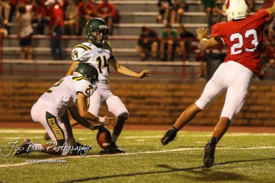 Pratt Greenback #14 Daniel Sanchez kicks a Point After Touchdown as #2 Kaden Evert holds the ball in the in the fourth quarter. The Pratt Greenbacks defeated the Hoisington Cardinals by a score of 34 to 0 at Elton Brown Field in Hoisington, Kansas on August 31, 2018. (Photo: Joey Bahr, www.joeybahr.com)