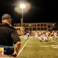 Hoisington Cardinal Head Coach Zach Baird looks on from the sideline in the fourth quarter. The Pratt Greenbacks defeated the Hoisington Cardinals by a score of 34 to 0 at Elton Brown Field in Hoisington, Kansas on August 31, 2018. (Photo: Joey Bahr, www.joeybahr.com)
