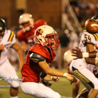 Hoisington Cardinal #2 Avery Brewer tosses the ball in the fourth quarter. The Pratt Greenbacks defeated the Hoisington Cardinals by a score of 34 to 0 at Elton Brown Field in Hoisington, Kansas on August 31, 2018. (Photo: Joey Bahr, www.joeybahr.com)