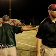 Pratt Greenback Head Coach Jamie Cruce pats the back of Hoisington Cardinal Head Coach Zach Baird after the game. The Pratt Greenbacks defeated the Hoisington Cardinals by a score of 34 to 0 at Elton Brown Field in Hoisington, Kansas on August 31, 2018. (Photo: Joey Bahr, www.joeybahr.com)