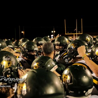 Pratt Greenback Head Coach Jamie Cruce addresses his players after the game. The Pratt Greenbacks defeated the Hoisington Cardinals by a score of 34 to 0 at Elton Brown Field in Hoisington, Kansas on August 31, 2018. (Photo: Joey Bahr, www.joeybahr.com)