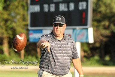 Central Plains Oiler Head Coach Chris Steiner tosses the ball to a player during warmups. The Central Plains Oilers defeated the Little River Redskins by a score of 46 to 0 at Community Memorial Park in Little River, Kansas on September 21, 2018. (Photo: Joey Bahr, www.joeybahr.com)
