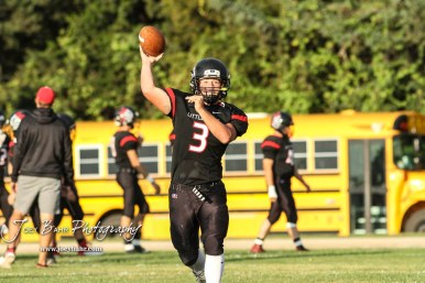 Little River Redskin #3 Graham Stephens throws a pass during warmups. The Central Plains Oilers defeated the Little River Redskins by a score of 46 to 0 at Community Memorial Park in Little River, Kansas on September 21, 2018. (Photo: Joey Bahr, www.joeybahr.com)