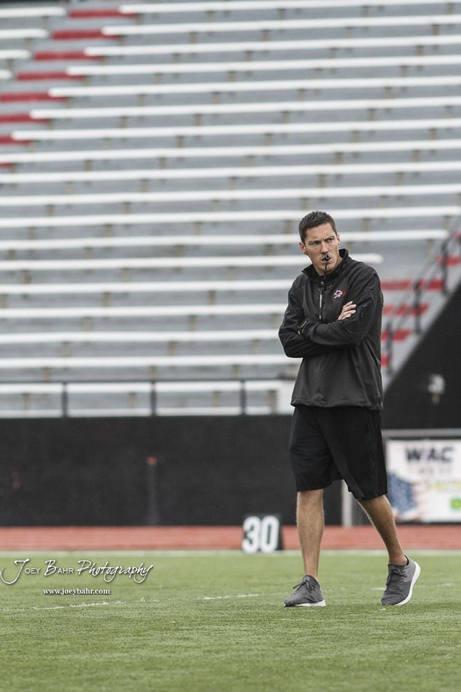 Great Bend Panther Head Coach Erin Beck watches his players during warm ups prior to the game. The Hays Indians faced off with the Great Bend Panthers at Memorial Stadium in Great Bend, Kansas on September 7, 2018. (Photo: Joey Bahr, www.joeybahr.com)