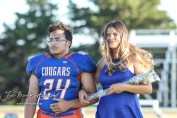Junior attendants Martin Lopez and Amanda Sizemore stand during Homecoming festivities. The Stafford Trojans faced the Otis-Bison Cougars at Cougar Field in Otis, Kansas on September 14, 2018. (Photo: Joey Bahr, www.joeybahr.com)