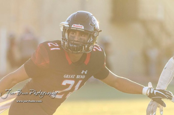 Great Bend Panther #21 David Garcia tracks the ball during a pregame warmup. The Great Bend Panthers defeated the Garden City Buffaloes 49 to 6 at Memorial Stadium in Great Bend, Kansas on October 19, 2018. (Photo: Joey Bahr, www.joeybahr.com)
