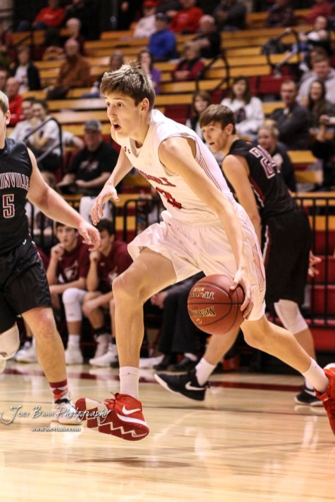 Hoisington Cardinal #0 Drew Nicholson drives the baseline towards the basket in the first quarter. The Hoisington Cardinals defeated the Plainville Cardinals by a score of 70 to 53 at the Hoisington Activity Center in Hoisington, Kansas on February 5, 2019. (Photo: Joey Bahr, www.joeybahr.com)