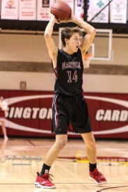 Plainville Cardinal #14 Kaiden Van Schuyver looks for an open teammate in the second quarter. The Hoisington Cardinals defeated the Plainville Cardinals by a score of 70 to 53 at the Hoisington Activity Center in Hoisington, Kansas on February 5, 2019. (Photo: Joey Bahr, www.joeybahr.com)
