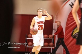 Hoisington Cardinal #25 Braxton Donovan calls the next play as he bring the ball down the court in the third quarter. The Hoisington Cardinals defeated the Plainville Cardinals by a score of 70 to 53 at the Hoisington Activity Center in Hoisington, Kansas on February 5, 2019. (Photo: Joey Bahr, www.joeybahr.com)
