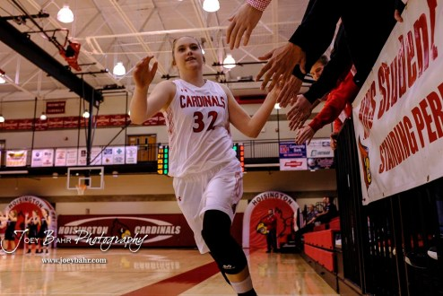 Hoisington Lady Cardinal #32 Kelsi Dalton greets fans during player introductions. The Plainville Lady Cardinals defeated the Hoisington Lady Cardinals by a score of 49 to 35 at the Hoisington Activity Center in Hoisington, Kansas on February 5, 2019. (Photo: Joey Bahr, www.joeybahr.com)