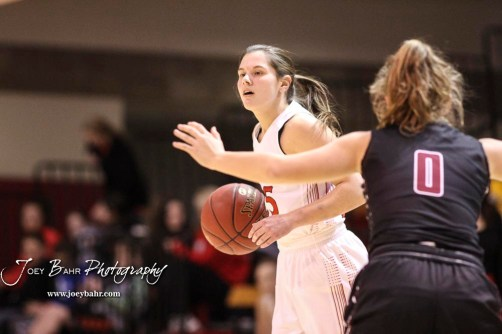 Hoisington Lady Cardinal #25 Maleigha Schmidt sets up the offense in the first quarter. The Plainville Lady Cardinals defeated the Hoisington Lady Cardinals by a score of 49 to 35 at the Hoisington Activity Center in Hoisington, Kansas on February 5, 2019. (Photo: Joey Bahr, www.joeybahr.com)