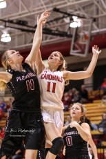 Plainville Lady Cardinal #11 Kate McClellan challenges Hoisington Lady Cardinal #11 Keeley Wolf in the air under the basket in the first quarter. The Plainville Lady Cardinals defeated the Hoisington Lady Cardinals by a score of 49 to 35 at the Hoisington Activity Center in Hoisington, Kansas on February 5, 2019. (Photo: Joey Bahr, www.joeybahr.com)