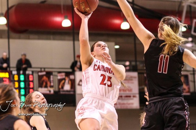 Plainville Lady Cardinal #11 Kate McClellan tries to block a shot by Hoisington Lady Cardinal #25 Maleigha Schmidt in the first quarter. The Plainville Lady Cardinals defeated the Hoisington Lady Cardinals by a score of 49 to 35 at the Hoisington Activity Center in Hoisington, Kansas on February 5, 2019. (Photo: Joey Bahr, www.joeybahr.com)
