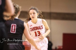 Hoisington Lady Cardinal #13 Isabelle Gonzalez brings the ball to the top of the key in the first quarter. The Plainville Lady Cardinals defeated the Hoisington Lady Cardinals by a score of 49 to 35 at the Hoisington Activity Center in Hoisington, Kansas on February 5, 2019. (Photo: Joey Bahr, www.joeybahr.com)