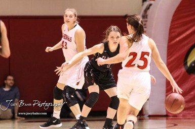 Plainville Lady Cardinal #1 Jersey Kaiser defends as Hoisington Lady Cardinal #25 Maleigha Schmidt brings the ball into the far court in the second quarter. The Plainville Lady Cardinals defeated the Hoisington Lady Cardinals by a score of 49 to 35 at the Hoisington Activity Center in Hoisington, Kansas on February 5, 2019. (Photo: Joey Bahr, www.joeybahr.com)