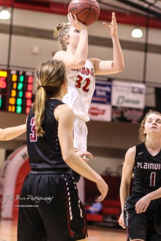 Hoisington Lady Cardinal #32 Kelsi Dalton shoots a jump shot in the third quarter. The Plainville Lady Cardinals defeated the Hoisington Lady Cardinals by a score of 49 to 35 at the Hoisington Activity Center in Hoisington, Kansas on February 5, 2019. (Photo: Joey Bahr, www.joeybahr.com)