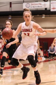 Hoisington Lady Cardinal #32 Kelsi Dalton brings the ball down to the baseline in the third quarter. The Plainville Lady Cardinals defeated the Hoisington Lady Cardinals by a score of 49 to 35 at the Hoisington Activity Center in Hoisington, Kansas on February 5, 2019. (Photo: Joey Bahr, www.joeybahr.com)
