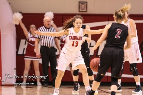 Hoisington Lady Cardinal #13 Isabelle Gonzalez watches Plainville Lady Cardinal #2 Halli Friend while on defense in the in the third quarter. The Plainville Lady Cardinals defeated the Hoisington Lady Cardinals by a score of 49 to 35 at the Hoisington Activity Center in Hoisington, Kansas on February 5, 2019. (Photo: Joey Bahr, www.joeybahr.com)