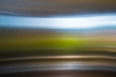 Colorful, Blurry Landscape Reflected in Stainless Steel