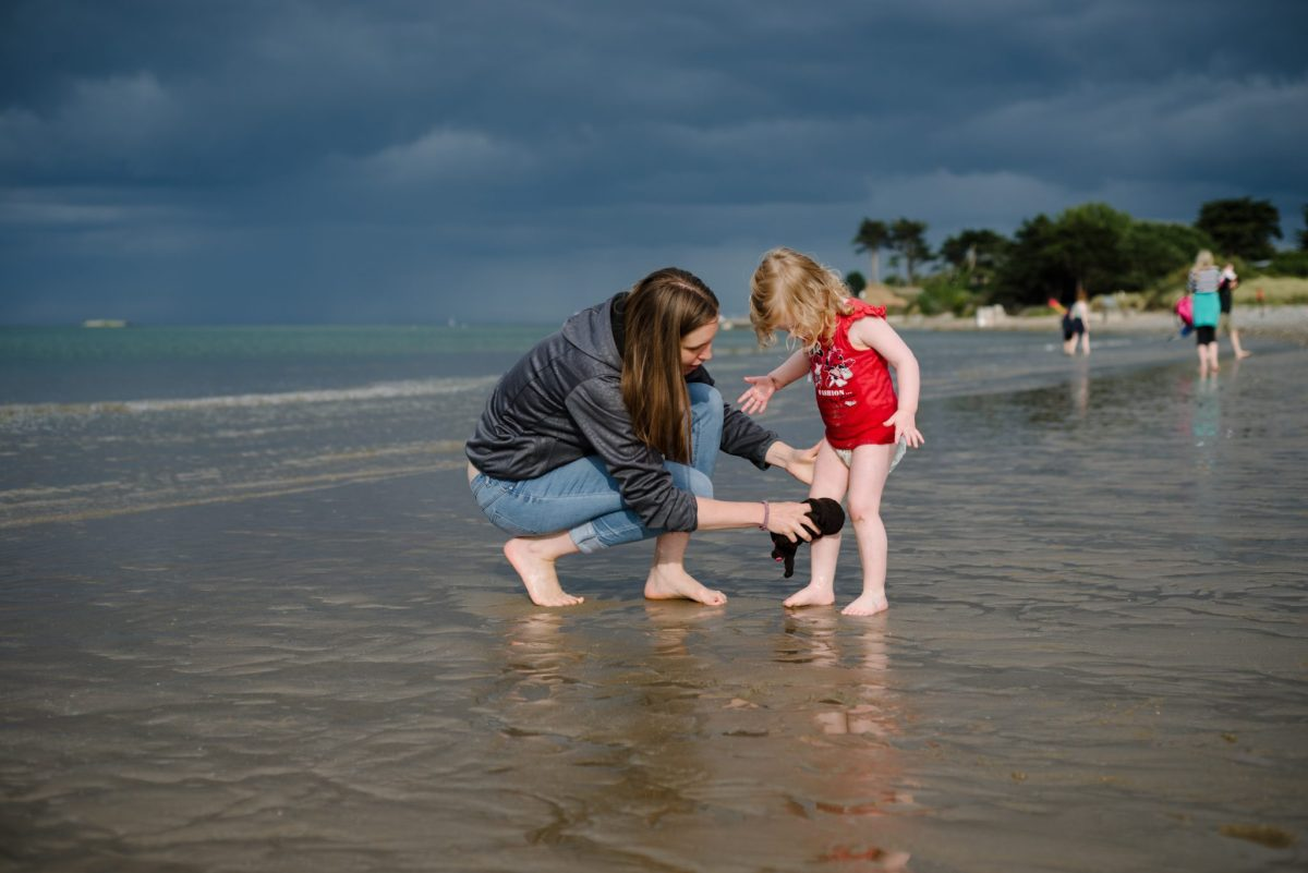 Mum and her daughter at the beach, photo taken by her husband. 3rd of 8 Ways for mums to exist in family photos