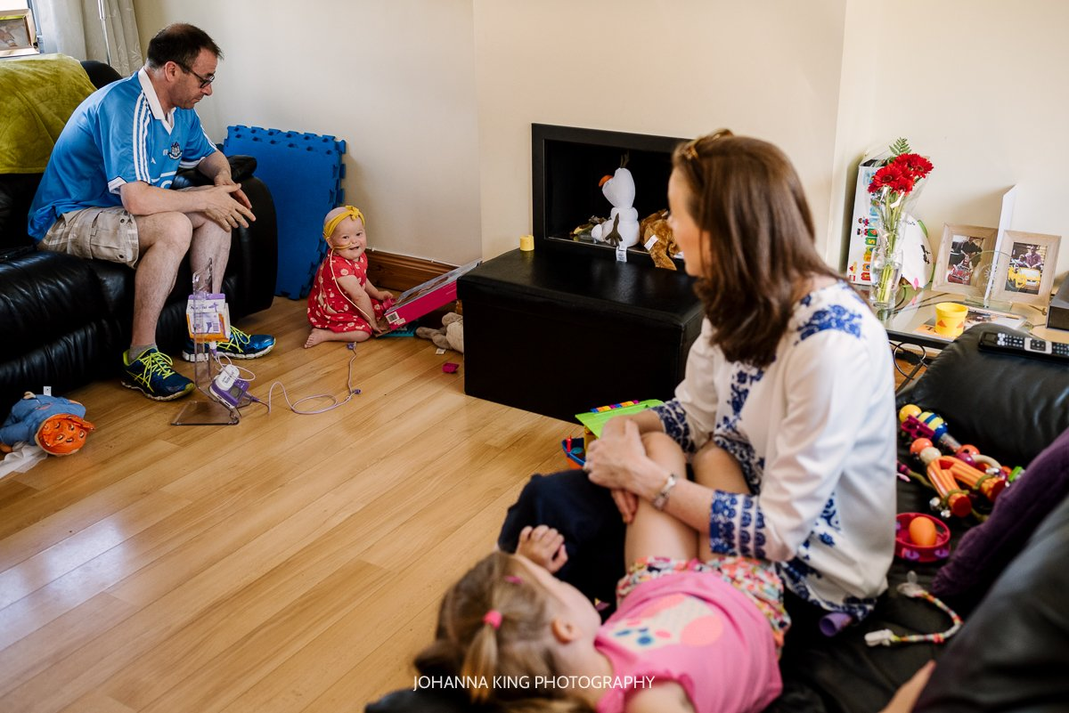 The family playing together in their living room