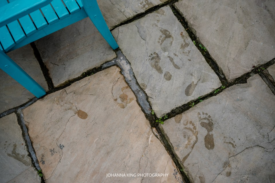 Wet foot steps on the tiles.