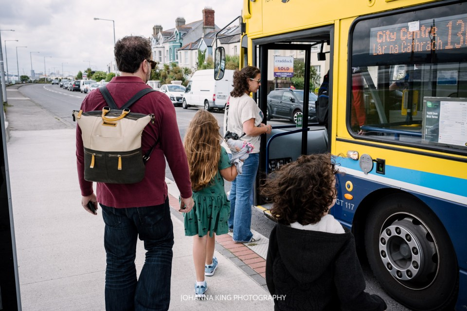Family stepping in Dublin bus in Clontarf on their vacation