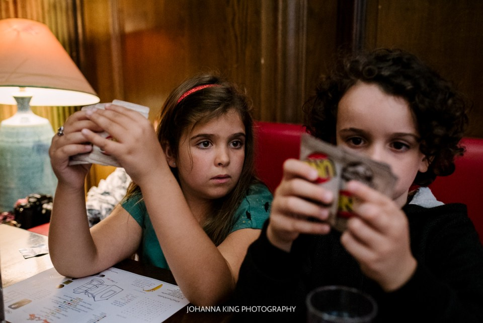 Siblings playing UNO in a restaurant in Dublin