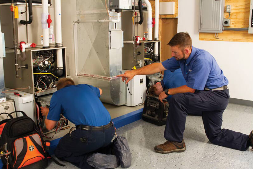 hvac technicians troubleshooting a system