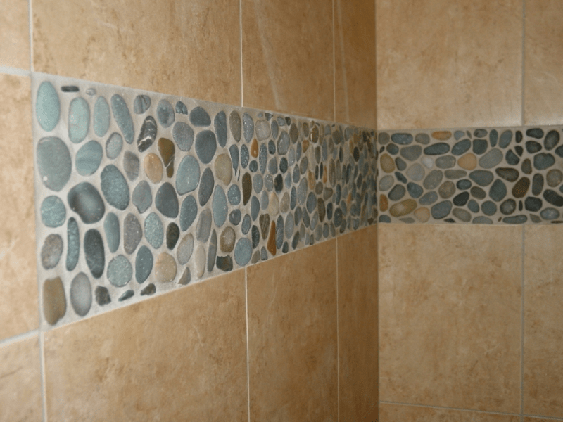 Pebble Shower Floors for Tiled Showers   How to Install Small Rocks     River rocks