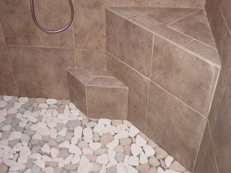 Pebble Shower Floors for Tiled Showers   How to Install Small Rocks     Shower floor edge is shown