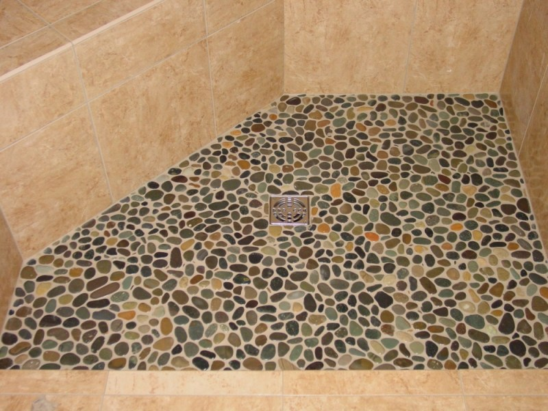 Pebble Shower Floors for Tiled Showers   How to Install Small Rocks     Shows rounded river rocks in a shower floor