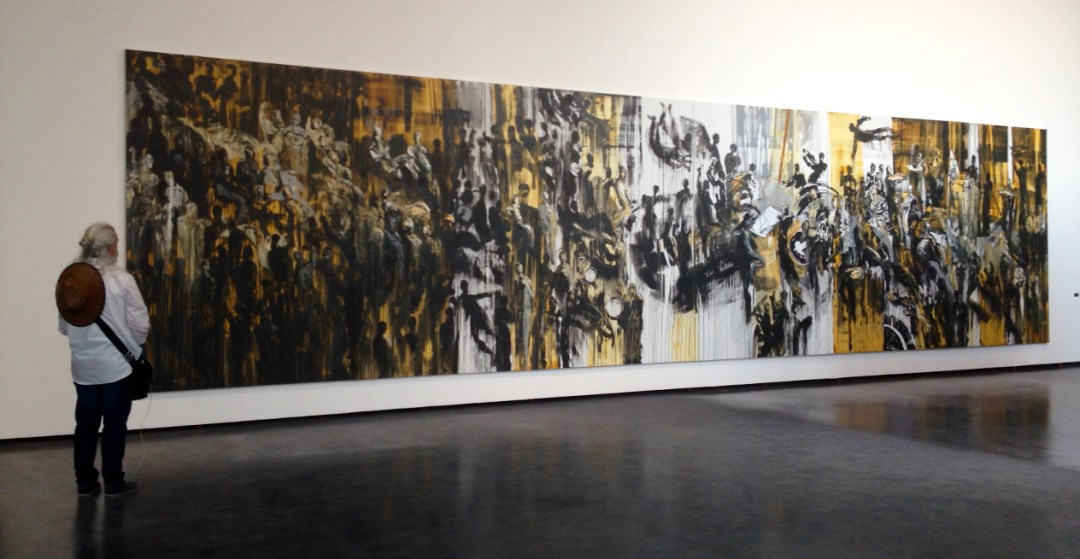 "Here I am with Syrian artist Ahmad Moualla's giant painting, ""People and Power."""