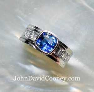 2.25CT Sapphire Diamond accents set in Platinum