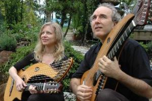 john doan and murial anderson harp guitars in garden